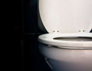An image of a toilet using a sewage ejector for proper functioning.